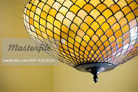 stained glass ceiling light. Yellow Stained Glass Ceiling Light - Stock Photo H