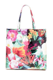 reese erspoon looks stylish message adorned bag as she ted baker london tote at nordstrom rack