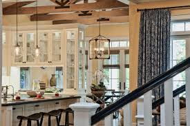 Rustic Kitchen Pendant Lights Mixing Glass Pendant Lights And A Rustic Caged Chandelier Creates