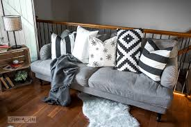 diy stencilled snowflake pillow among other ikea black and white pillows on the stocksund sofa