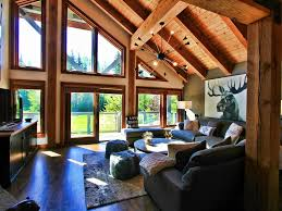 Living Room at Northwood Chalet Whistler with views of mountains & golf  course