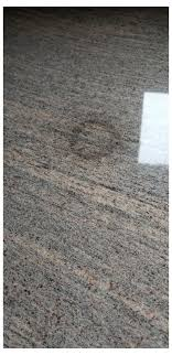 have tried to remove stain using baking soda paste overnight twice have ordered a grease removing product for granite from dupont