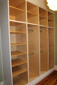 Custom Closet Organizer separate sections could have different level rods  for different types of clothes and accessories.