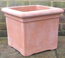I think square planters would look better for the bays by the side  entrance. A square terracotta version.