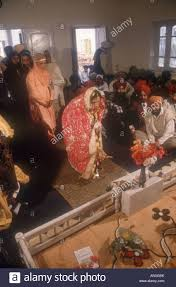 giving gifts to the bride and groom at a sikh wedding ceremony in patiala punjab india