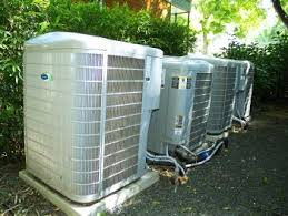 carrier 59mn7. condensing units lined up neatly in a backyard area. carrier 59mn7 1