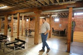 Storage with office space Self Storage Architect Lyle Murtha Walks Through The New Basement Shift Cowork Office Space In The Basement Of Stateline No Architects On Thursday Morning In Atlanta Homes Lifestyles Basement Shift Transforms Former Storage Space Into Hip Cowork