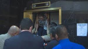 people stuck in elevator. people stuck in elevator
