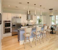 custom kitchen lighting. These Narrow, Gilded Lights Highlight The Breakfast Bar And Complement Warm Glow Of Custom Kitchen Lighting H