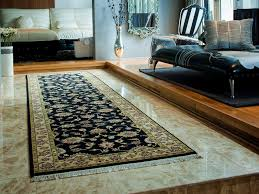 beautiful black and gold fl runner on a marble tiled floor beautified the walk way of