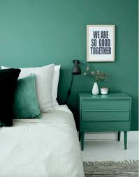 emerald green walls bedroom with emerald green walls and bedside table contrasting with white