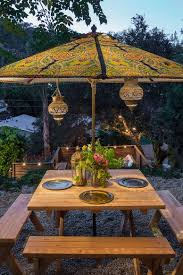 outdoor terrace lighting. Moroccan Lanterns And Patterned Umbrella Complete An Eclectic Outdoor Dining Space [Design: Shannon Ggem Terrace Lighting