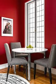 red dining table set red dining room small dining room windows white trim photograph grey chairs area rug wood floor