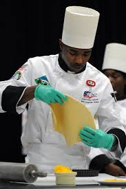 u s department of defense photo essay  army pfc jonathan ayers shapes and tossess dough during competition in the 2014 military culinary