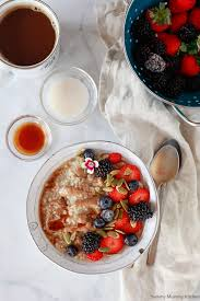 a beautiful bowl of steel cut oats with almond er maple syrup and fresh