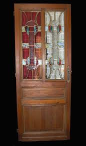 a beautiful french pine stained glass door this door features a pleasing combination of stained beveled and patterned glass panes
