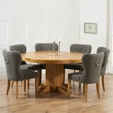 trina solid oak round dining table with 6 kalvin grey chairs 4418