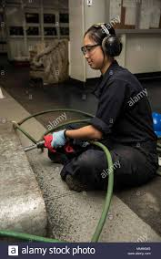 170911-N-LN243-085 PORTSMOUTH, Va. (Sept. 11, 2017) Seaman Jenny Porter,  from Cocoa Beach, Fla., needle guns the deck aboard the aircraft carrier  USS Dwight D. Eisenhower (CVN 69)(Ike). Ike is preparing for a
