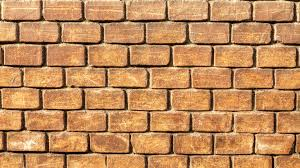 old yellow brick wall background