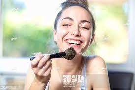 stock photo happy age applying makeup