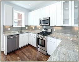 gray quartz countertops with white cabinets a kitchen granite s backsplash