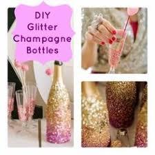 DIY Glittered Champagne Bottles. Glitter CenterpiecesTable  CenterpiecesCenterpiece IdeasAdult Party ...