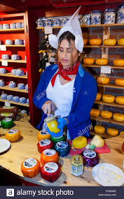 female w shop assistant in cheese shop wearing national dress female w shop assistant in cheese shop wearing national dress traditional costume and giving out