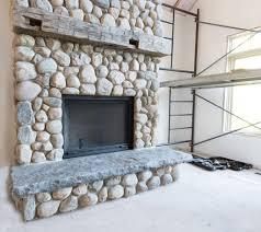 river rock stone fireplace