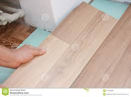 contractor install wooden laminate flooring with insulation and soundproofing sheets stock photo image of