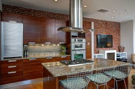 contemporary kitchen with brick accent wall