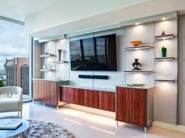 modern entertainment center in living room has custom designed base cabinets in a wood grain