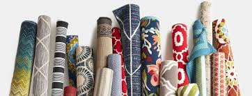 assorted rolled up outdoor rugs