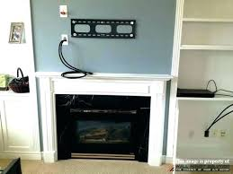 tv over fireplace ideas hanging over fireplace above hide wires brick hanging over fireplace mounting tv