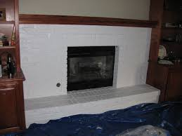 nice white painted fireplace with wooden mantel also grey wall painted in country living room decors