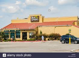 the exterior of an olive garden restaurant located at 2321 i 240 service road