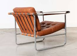 pair of leather and chrome lounge chairs by karl thut for stendig