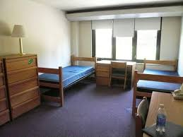 Dorm rooms come standard with two beds, a desk and some sort of storage  facility for your clothes.