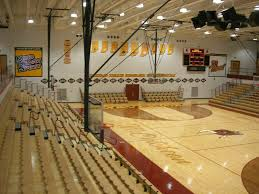 high school gym. The Renovations Involved Updates To Existing Gymnasium Space In Which Wood Floor Was Replaced With New Graphics; Added Bleachers And Light High School Gym