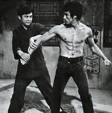 bruce lee formulated his own ab workout routine after studying books and bodybuilding guides to find the best exercises he could find for developing a