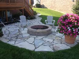 flagstone patio with grass. Landscaping \u2013 Flagstone Patio With Irregularly Shaped Stones: Nice Green Grass Walkway