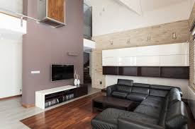 flat screen tv in living room designs. awesome luxury family room designs tv with large black leather sectional sofa wood floor elevated ceiling and small flat screen mounted on the wall in living e