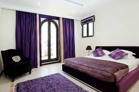 eye catching dark purple bedroom decoration of blue curtains grey and brown