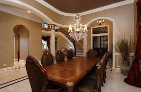 formal dining rooms with columns. traditional dining room with limestone tile floors, crown molding, columns, wainscoting, high formal rooms columns h