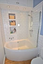 Simple White Small Bathroom Design With Corner Bath Tub And White