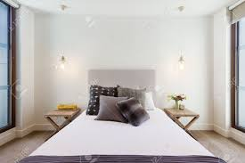 interior pendant lighting. Beautiful Hamptons Style Bedroom Decor In Luxury Home Interior With Pendant Lighting Stock Photo - 52581976
