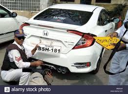 Car Number Plate Design In Pakistan Traffic Police Officials Removing Fancy Number Plate From A