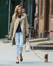 mixing high and low jessica hart paired a luxury burberry trench coat and a leather