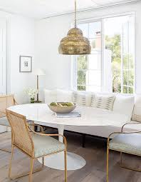 transitional dining e oval tulip table br perforated chandelier