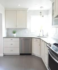 white kitchen with gray plank porcelain tile floor