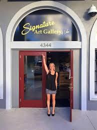 signature art gallery of vero front door signage